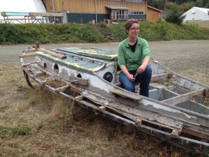 Jo, a 2015 Boat School student, sits on Felicity Ann's original cabin top.