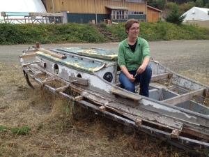 Jo, a 2015 Boat School student, sits on Felicity Ann's original cabin top.